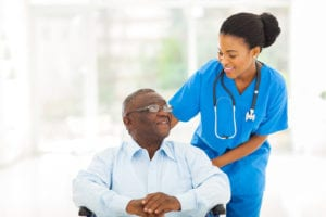 AL Advantage Senior Care Software - Assisted Living Caregiver helping African American resident