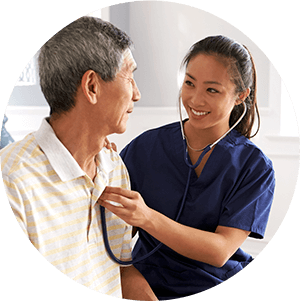 Senior Caregiver With Resident