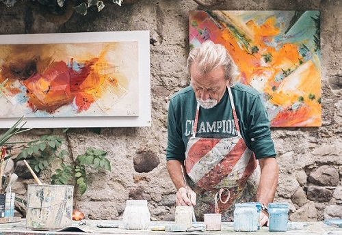Senior man creating art