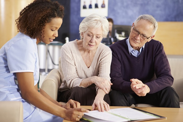 Senior Couple Meeting With Assisted Living Rep